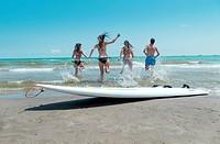 Surfers on the beach, Benicasim, Spain
