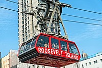 New York City, Manhattan. Looking up at the Roosevelt Island Tramway approaching the station in Manhattan.