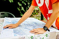 boy consult a hiking map