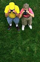 Two seniors looking through binoculars