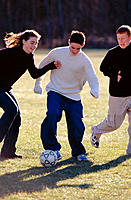 Teens playing soccer