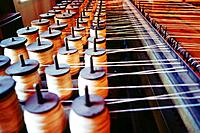 Bobbins at mechanized loom. Pawtucket. Rhode Island. USA