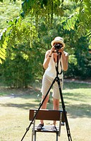 Photographer below a wingnut tree (Pterocarya fraxinifolia)