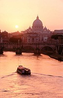 View on St. Angelo bridge over Tiber river and St. Peter´s basilica in background. Vatican City, Rome. Italy