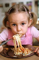 Nursery school. Gir eating spaghetti