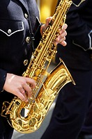 Young woman playing the saxophone. Holy Week. Albacete, Castilla-La Mancha , Spain.