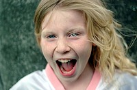 A little girl yells with joy
