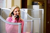 Businesswoman talking on telephone and smiling in an office