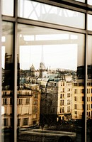 Reflections on window of Eiffel Tower and Paris skyline. Paris. France