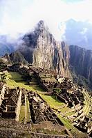 Machu Picchu with mist and clouds. Peru.
