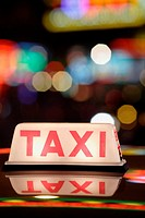 Close up of a taxi sign on the roof of taxis, standing in a row in the amusement center of Wanchai, Hong Kong Island, Hong Kong, China, East Asia
