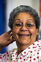 Hispanic elderly woman posing