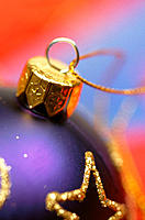 Purple and gold spherical Christmas tree ornament
