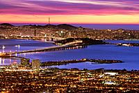 Downtown San Francisco at dusk as seen from Treasure Island, The Bay Bridge, Hierbabuena Island and Downtown San Francisco at dusk as seen from the Be...