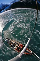 Yacht breaking ice while cruising up west arm of Seno fjord Pia Isla Grande Tierra del Fuego Chile