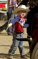 A young cowboy tries his hand at roping at the Tucson Rodeo in Tucson, Arizona.