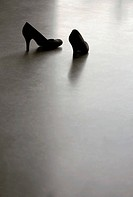 Two empty high heel shoes