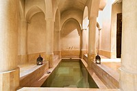 Morocco, Marrakesh, Riad, the Hammam  with its tadelakt plaster columns and pool subtly lit by shafts of light