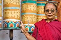 India, Sikkim, Tashiding, Tashiding Gompa, Woman spinning prayer wheel