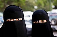 Arab women wearing traditional black Burka.