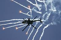 Royal Netherlands Air Force Apache AH-64D firing decoy flares RIAT 2005 RAF Fairford Gloucestershire England UK