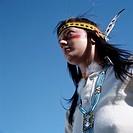 Indigenous woman, america; looking off.