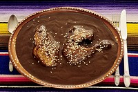 The Mexican dish, Chicken with Mole Poblano, a thick, chocolate-tinged sauce