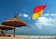 Sun shade at the ´Sailing Club´ beach bar at Nha Trang´s beach promenade Tran Phu, Vietnam