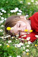 Little girl sleeping in meadow