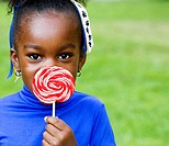 A little black girl and her swirly lollipop