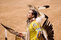 American Lakota Indian warrior in traditional ceremonial oufit at pow-wow