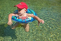 boy with a rubber ring on a river in Ludiente, Castellón