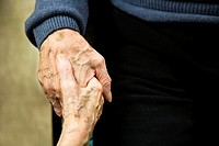 Old man and woman holding hands