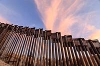 Sunset at United States border fence, US/Mexico border, east of Nogales, Arizona, USA