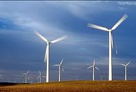 Spinning wind turbines at dusk, Rio Vista, California USA
