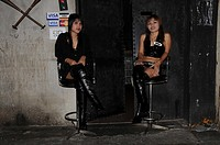 Two Asian Dominas sitting infront of a Club in Bangkok