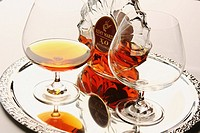 Cognac bottle and goblets on a serving tray