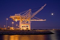 USA, California, Alameda County, San Francisco Bay Area, Port of Oakland, Alameda Estuary, container gantry cranes, at dusk, full moon rising, view fr...