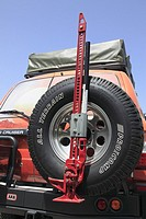 car-jack on spare tire of a Toyota Land Cruiser four wheel drive in the Sultanate of Oman, Middle East.