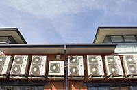Air conditioner units on exterior wall of building