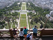 Tourist on the Eiffel Tower looking over Champs de Mars, Paris, France
