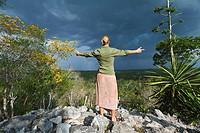 Guatemala, Peten, El Mirador basin, Woman on top of Temple Los Monos