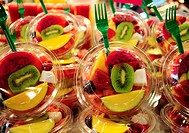 Fruit salads in La Boqueria market, Barcelona. Catalonia, Spain
