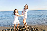 Mother and daughter having fun at the beach