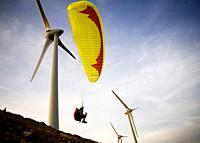 A paraglider is taking off in between the wind turbines, what would be totally insane if these would be in service: It was while the installation of t...