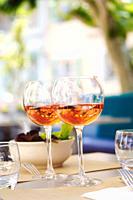 Glasses of rosé (Bandol AOC) on the table of a restaurant, La Cadière-d´Azur, Var, Provence-Alpes-Côte d´Azur, France