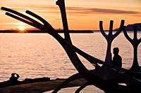 People enjoying the midnight sun  Solfar sculpture, Reykjavik Iceland