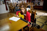 A Flamenco student plays the guitar during classes in Ubrique, Cadiz province, Andalusia, Spain, May 13, 2010