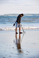 Metal detecting on Bournemouth beach, Bournemouth, England