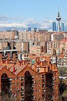Views from Madrid, with the Four Towers, telecommunications tower ´, Pirulí´, Kio Towers in the background and the Sierra of Madrid snowed.